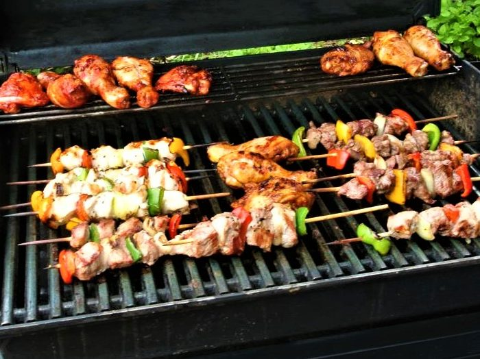 kebabs and chicken on a BBQ at the Queens Head Pub at Nutfield, Redhill, Surrey