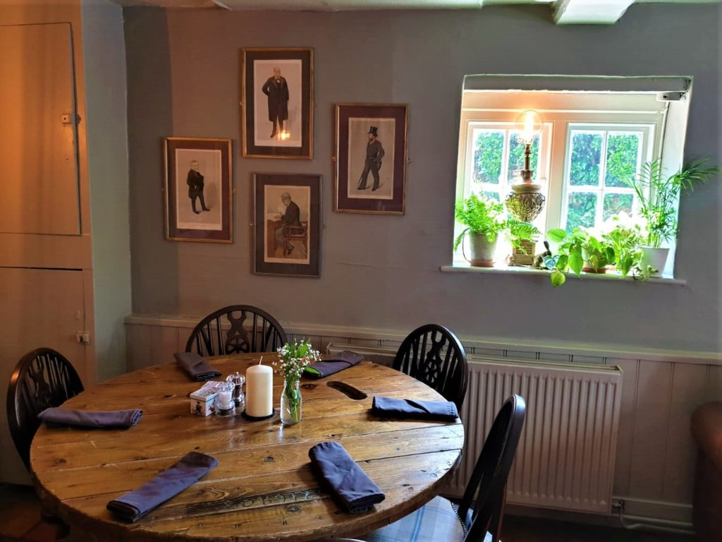 dining tables and sunny window at the Queens Head Pub at Nutfield, Redhill, Surrey