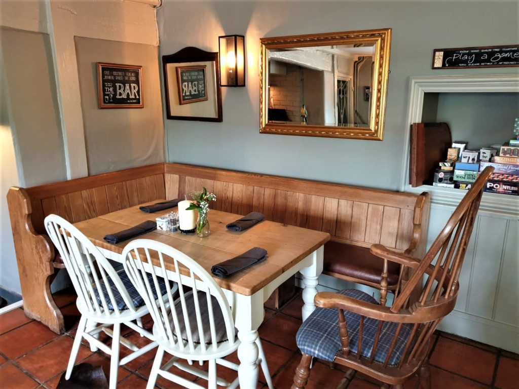 dining tables benches and chairs at the Queens Head Pub at Nutfield, Redhill, Surrey