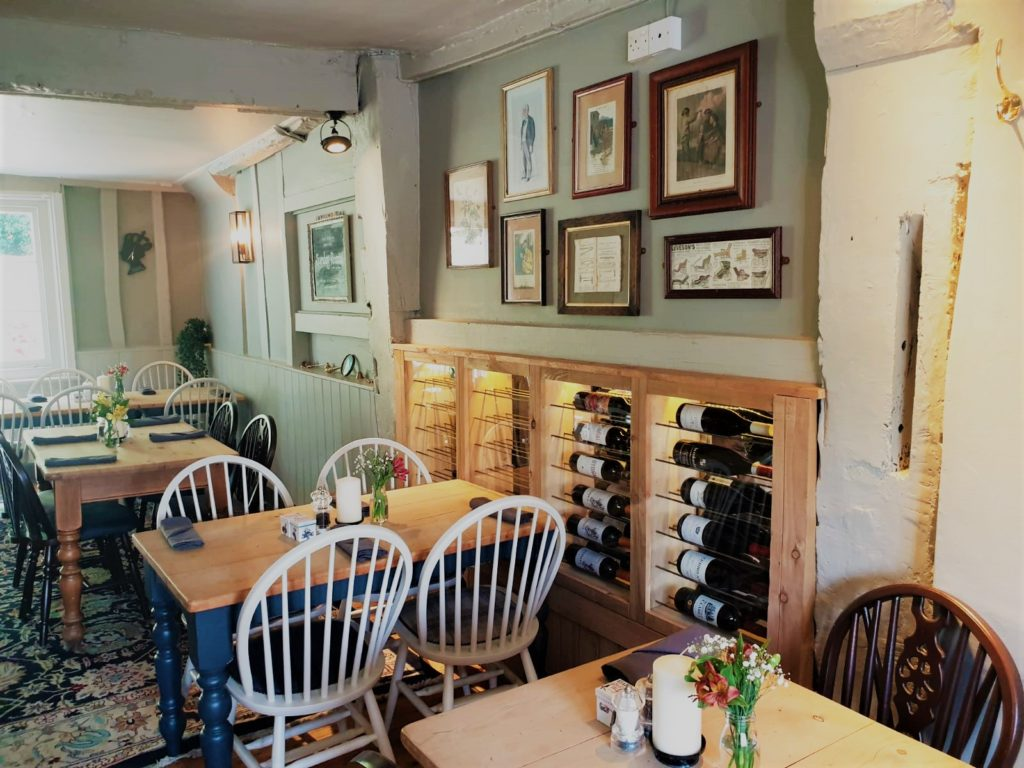 dining tables and wine racks at the Queens Head Pub at Nutfield, Redhill, Surrey
